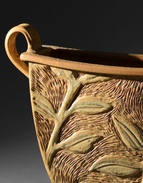 Gold bucket vase with relief carving jim shirl