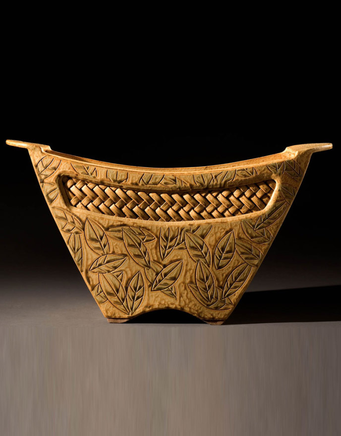 Gold vessel with woven inset